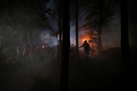 Cast members perform a night scene at the making of an epic film titled 'October 1' at a bush location in Akure, southwest Nigeria August 26, 2013.REUTERS/Akintunde Akinleye(NIGERIA)